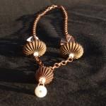 Collana bronzo sfere metallo 1