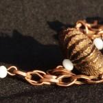 Collana bronzo sfere metallo 3